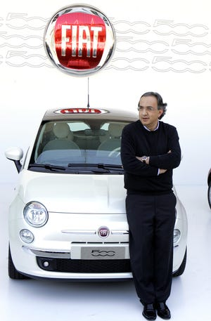 Fiat CEO Sergio Marchionne poses near the new Fiat 500, during the official presentation in Turin, Italy, in July 2007