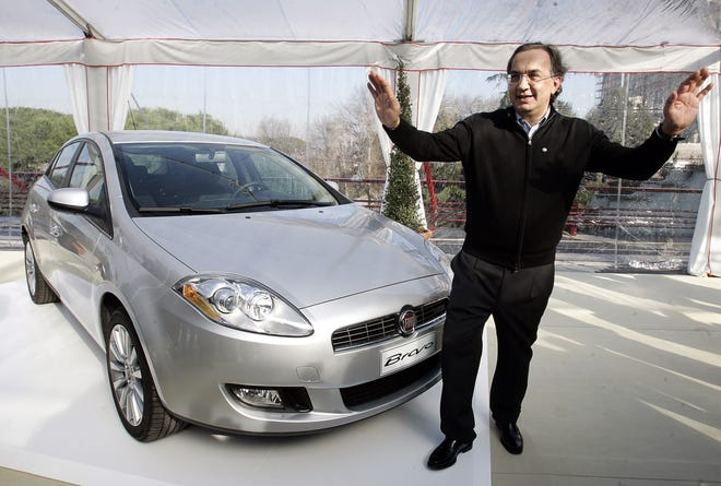 Fiat CEO Sergio Marchionne gestures next to the new Bravo car during its presentation to the press in Rome, Wednesday, Jan. 31, 2007.