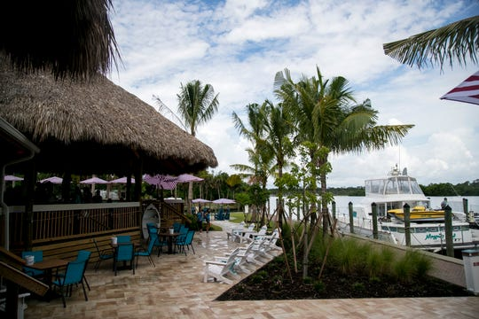 Guests can come by car or by boat to visit the Boathouse Tiki Bar & Grill on the Caloosahatchee in Fort Myers.