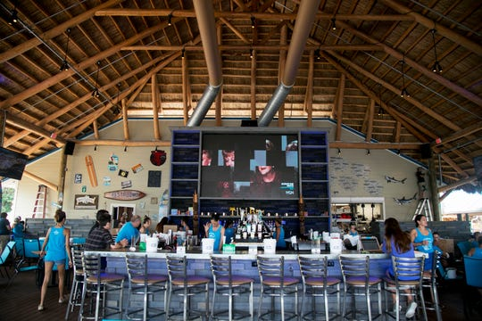 Employees set up Tuesday for opening day for the Boathouse Tiki Bar & Grill. The restaurant, which is on the Caloosahatchee opens on Thursday, July 26.