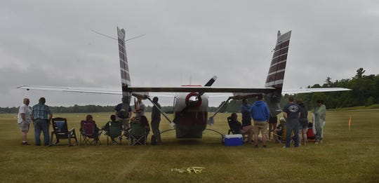 Aircraft enthusiasts gather around an airplane that had flown to Washington Island in advance of the Lions Club annual Fly-In Fish Boil on July 21. For more photos, visit doorcountyadvocate.com.