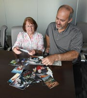 Sarajean and Allen Harmon look through photos of their daughter Valerie Tieman, Monday, July 24, 2018, who was killed in Maine in 2016 by her husband Luc Tieman.