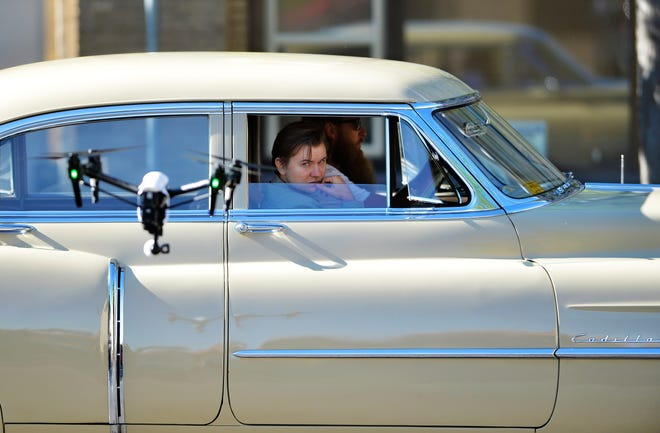 """Actor Kam Dabrowski, playing Frank Dryman, rides down Central Avenue in a 1951 Cadillac during a test shoot for the film """"Pellett"""" on Tuesday morning.  The film is based on a true story of the 1951 murder of Clarence Pellett by the hitchhiking teenager Frank Dryman who was convicted of the crime only to later violate his parole and evade capture for 38 years.  The filming shutdown the 100 block of Central Avenue on Tuesday morning and the crew will travel north to continue shooting in more rural locations."""