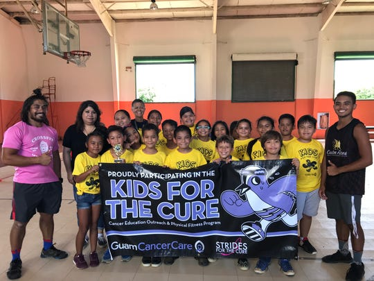 Ms. Campbell and her fourth-grade class pictured with Principal Hannah Gutierrez, Kids for the Cure coaches and Guam Cancer Care staff.