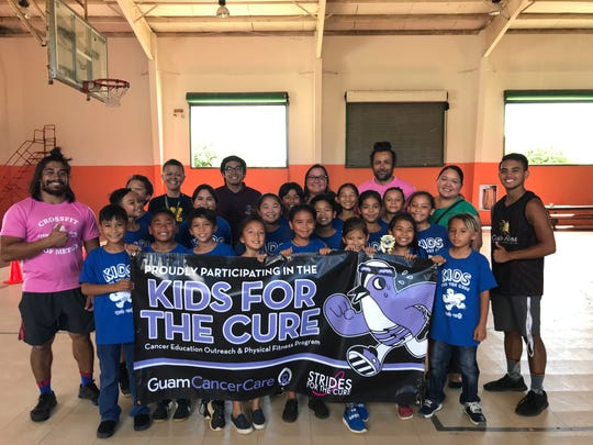 Ms. Collins and her fourth-grade class pictured with Principal Hannah Gutierrez, Kids for the Cure coaches and Guam Cancer Care staff.