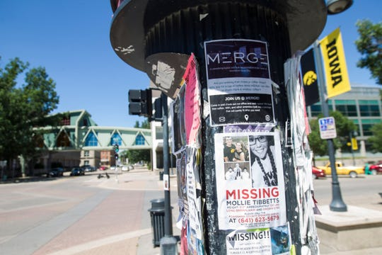 Flyers for missing University of Iowa student Mollie Tibbetts are seen on the corner of Dubuque Street and Iowa Avenue on Tuesday, July 24, 2018, in Iowa City, Iowa.