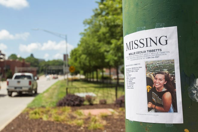 Flyers for missing University of Iowa student Mollie Tibbetts are seen on the corner of Burlington and Madison Streets Tuesday, July 24, 2018, in Iowa City, Iowa.