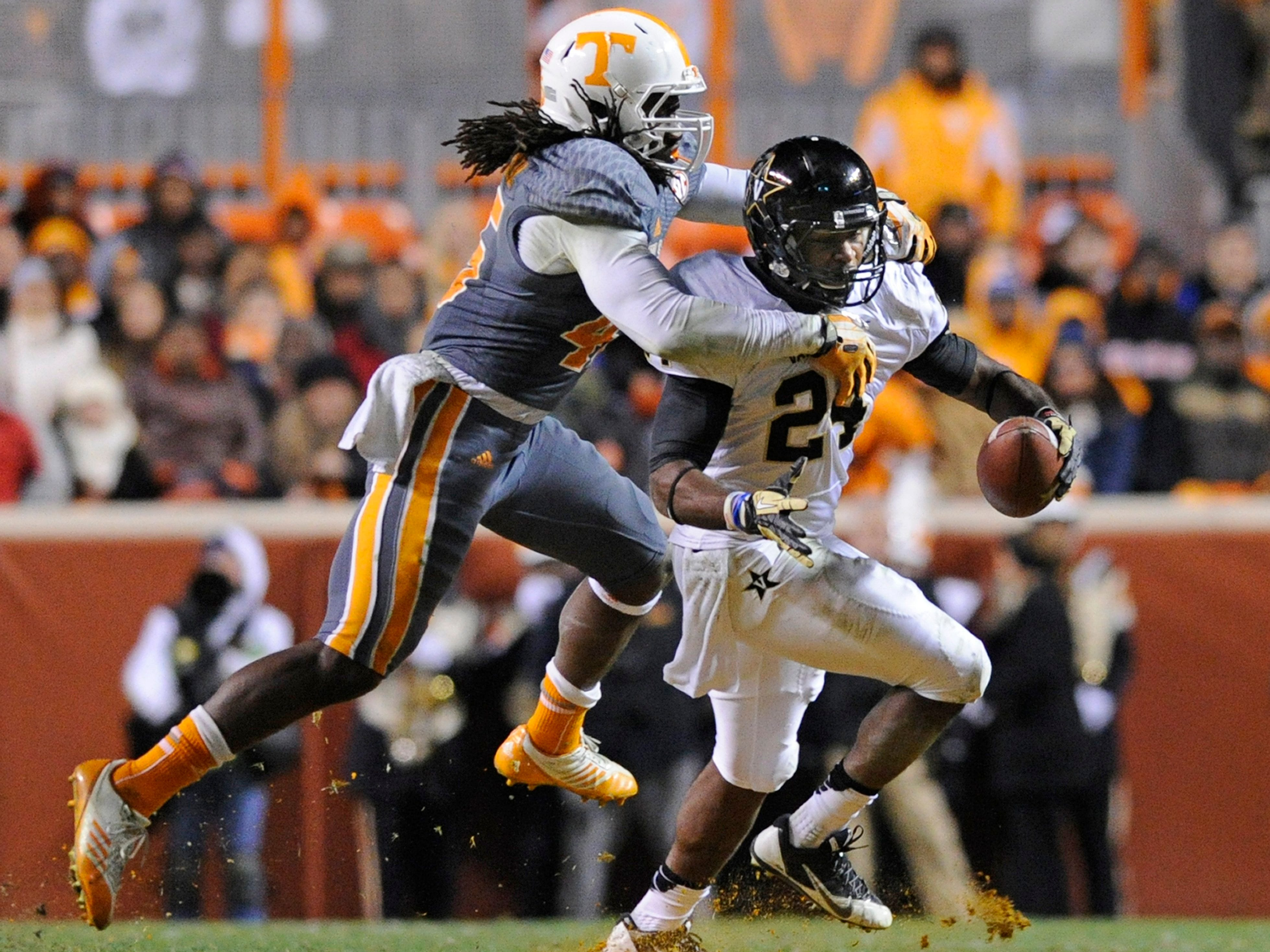 Tennessee linebacker A.J. Johnson (45) tackles Vanderbilt running back Wesley Tate (24) during the first half at Neyland Stadium in Knoxville on Saturday, Nov. 23, 2013.