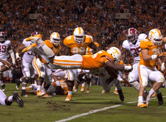 Tennessee's A.J. Johnson dives for a touchdown against Alabama in the second quarter at Neyland Stadium Saturday. It was Tennessee's only TD in the 44-13 loss.
