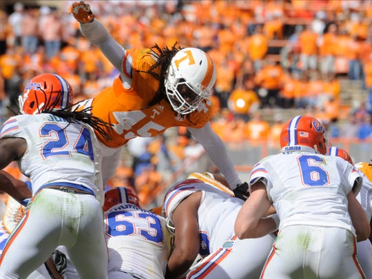 Tennessee's A.J. Johnson leaps over the Florida offensive line during the second half at Neyland Stadium on Saturday, Oct. 4, 2014 in Knoxville, Tenn.. Tennessee lost to Florida 10-9.