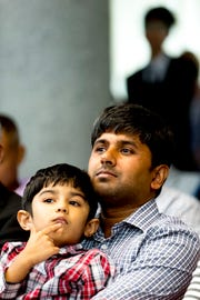 Santosh Nayak and his son Arnaya, 5, during his naturalization at a U.S. Naturalization Ceremony at the City County Building in Knoxville, Tennessee on Tuesday, July 24, 2018.
