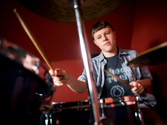 """Ethan Franklin got his first drum kit at age 4. """"I just banged the crap out of them and busted the heads open,"""" he said."""