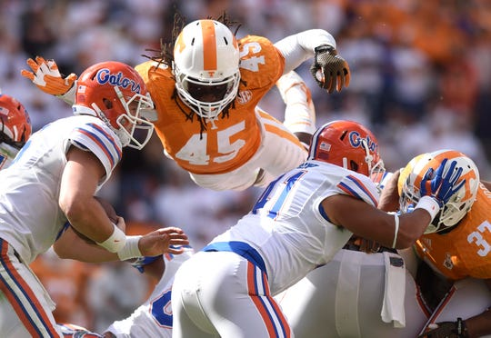 Tennessee linebacker A.J. Johnson (45) leaps over the Florida offensive line during the second half at Neyland Stadium on Saturday, Oct. 4, 2014 in Knoxville, Tenn.