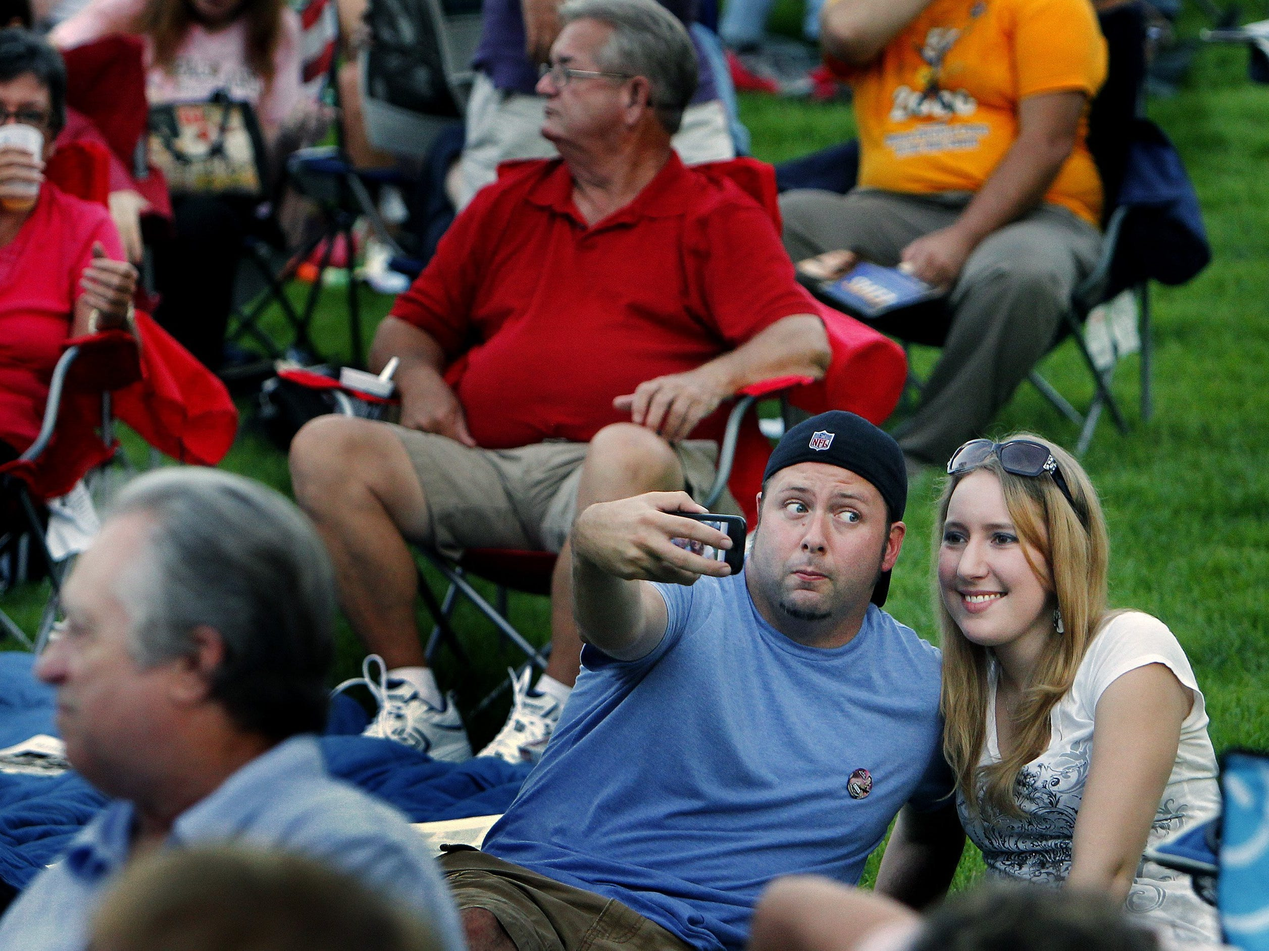 081011 INSIDE STAND ALONE - August 9, 2011 - Shane McCrea (left) makes a funny face as he strikes a pose while taking a picture with friend Jamie Hanskiewicz (cq) (right) during the Rock 'n' Roll Anniversary Concert at Levitt Shell in Overton Park Tuesday evening. Hundreds gather at for the special kick-off event for Elvis Week that commemorates a performance by Elvis Presley in the shell that many historians now consider to be the first live rock 'n' roll concert. (Mark Weber/ The Commercial Appeal)