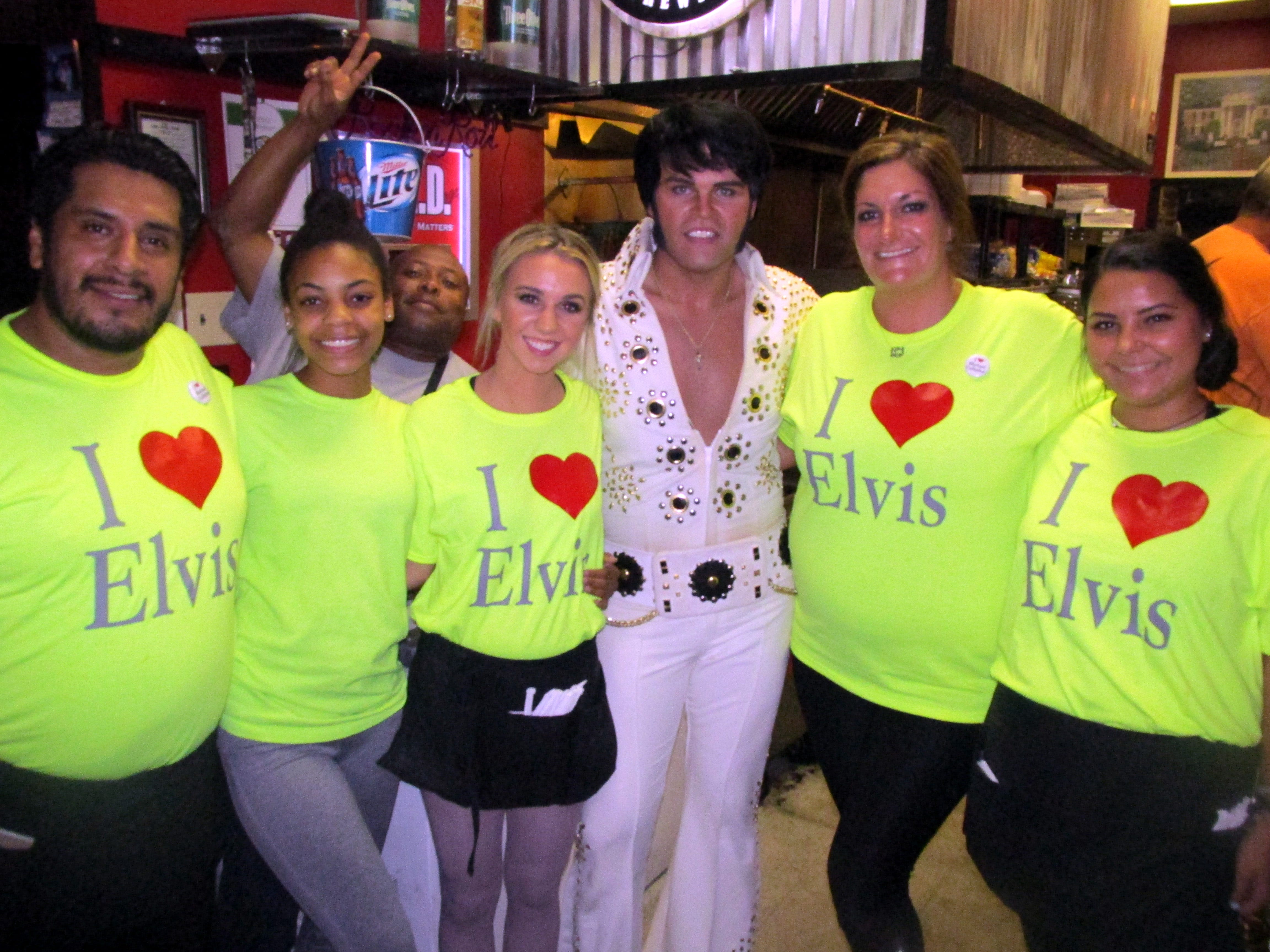 Elvis tribute artist Michael Cullipher performed at the Rock 'N Roll Cafe. With him are some of the restaurant employees: Rudy Martinez,  KeAndrea Foster, Marcelloous Everhart, McKenzie Bryant, Hannah Hastings and Rebecca Kettler. (Michael Donahue/Commercial Appeal) Aug. 10 2016