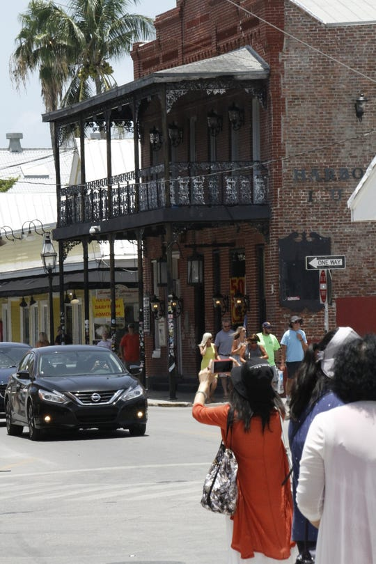 Tourists pack the streets of Key West almost one year after Hurricane Irma shutoff parts of the Island.