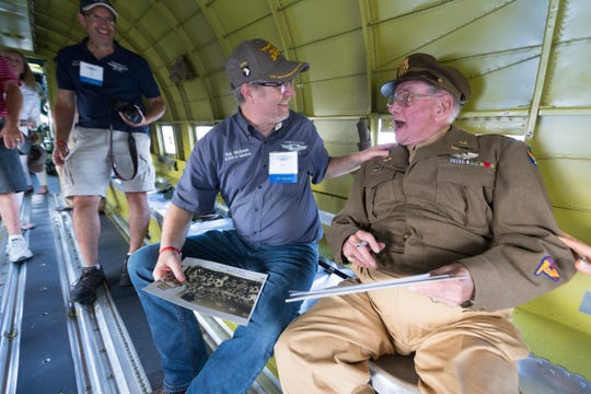 """World War II veteran and C-47 pilot David Hamilton (right) speaks with Rob Wickman at the EAA AirVEnture in Oshkosh. They are aboard a C-47 named, """"That's All, Brother""""."""