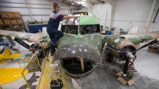 """Les Andersen replaces skin on """"That's All, Brother"""" at Basler Turbo Conversions in Oshkosh, Wis. in 2015."""