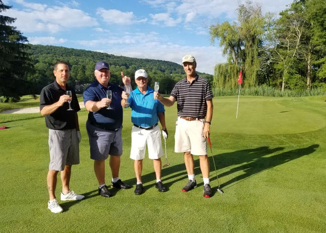 Bill Findlay (second from left) sank his first hole in one Saturday, while playing with Steve Moore, Tom Urmanowicz and Fran Gavin.
