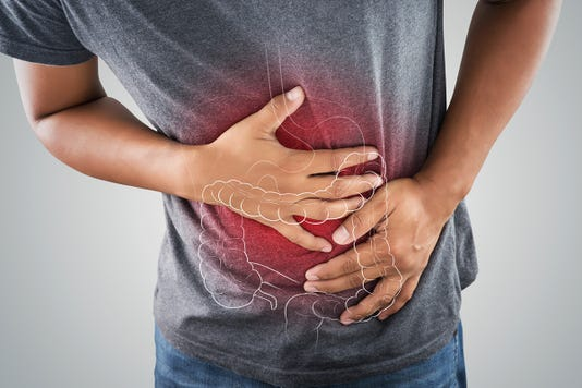 The Photo Of Large Intestine Is On The Man S Body Against Gray Background People With Stomach Ache Problem Concept Male Anatomy