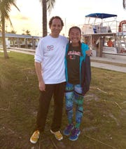 """Dr. Neil Hammerschlag stands with Isabella Stapp, a Seacrest Country Day School sophomore invited to join the University of Miami's shark research and conservation program on a shark tagging expedition that included Barbara Corcoran of the reality TV show """"Shark Tank."""""""