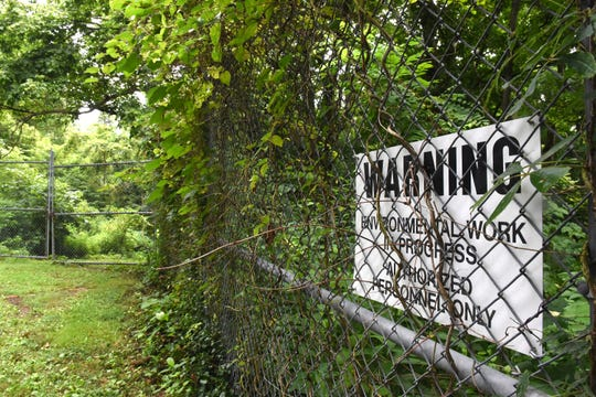 """The former location of Granville Solvents at 300 Palmer Lane. The property is fenced off with a sign warning of """"environmental work in progress."""" The company, a solvent reclamation and recycling center, was shut down in 1986 by a court order."""