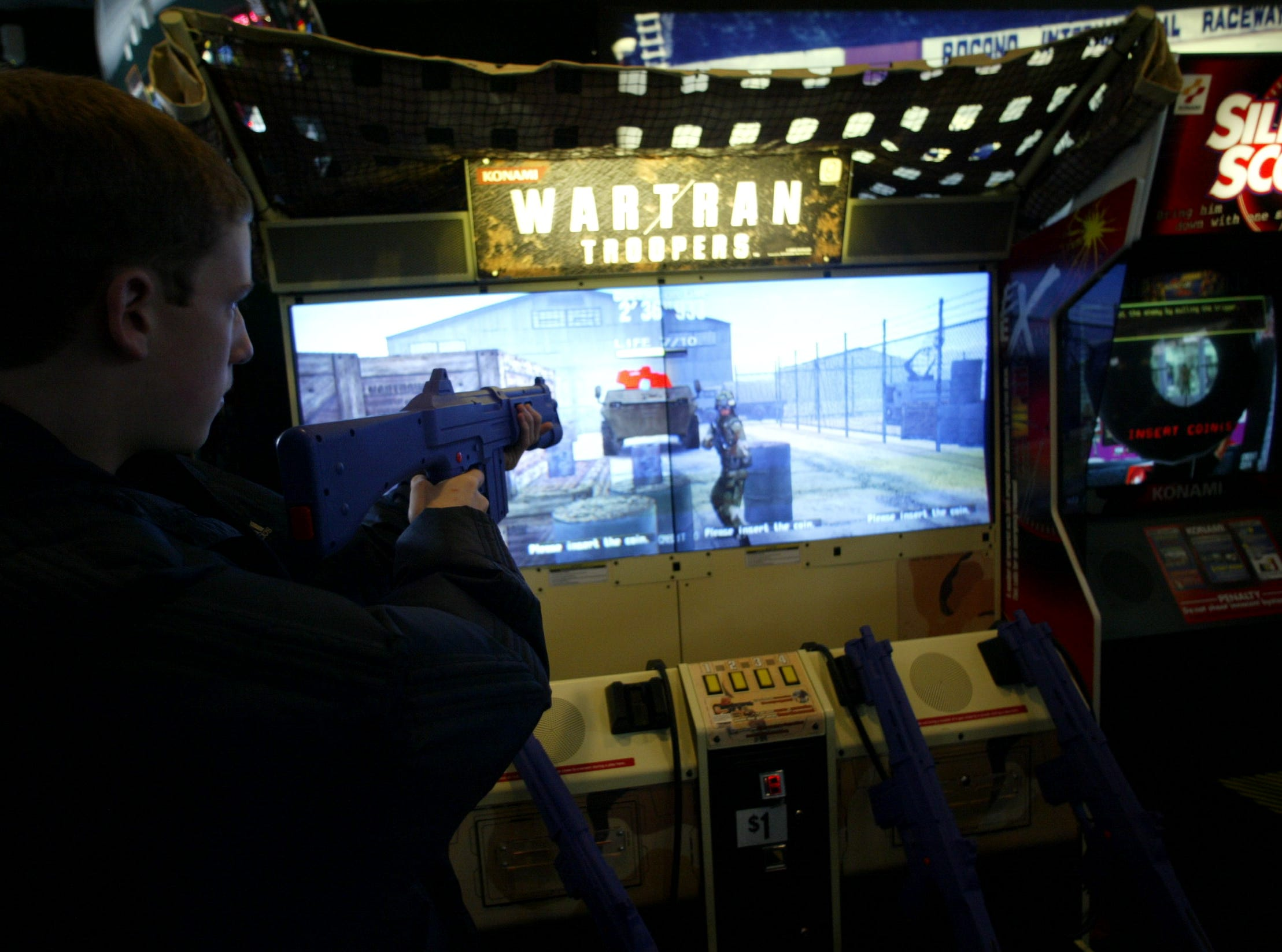 The Fun n' Games Arcade  at the Willowbrook Mall.  A player tries the Wartran game on December 20, 2003.