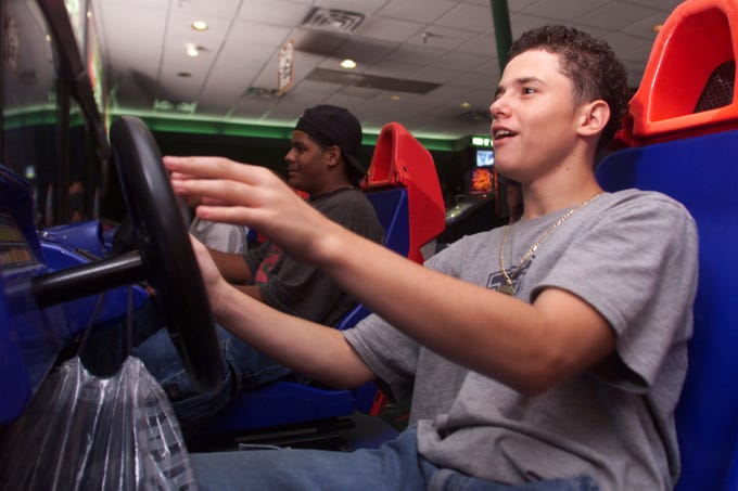 Kasem Osmanoski of Paterson is shown at Fun 'N' Games at the Willowbrook Mall, playing a race car arcade game on September 4, 2000.