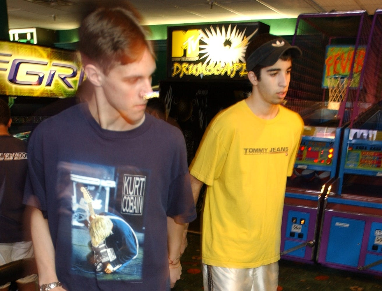 Dance, Dance Revolution video game at Fun N Games arcade at Willowbrook Mall being played by (L) Justin Dougherty of Little Falls and (R) Joe DeFabrizio of Totowa. Taken on July 15, 2002.