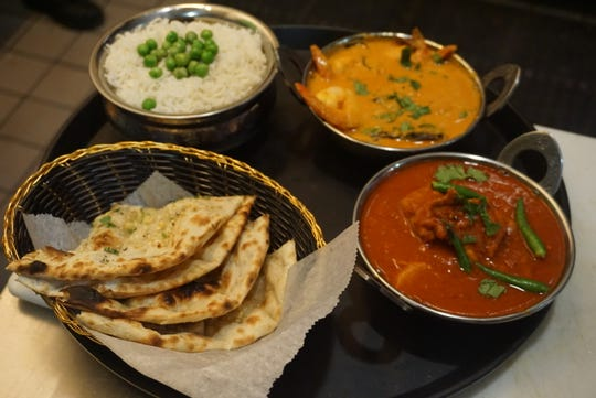 Chicken vindaloo with basmati rice, goan shrimp curry and garlic rosemary naan at Saffron in Wyckoff.