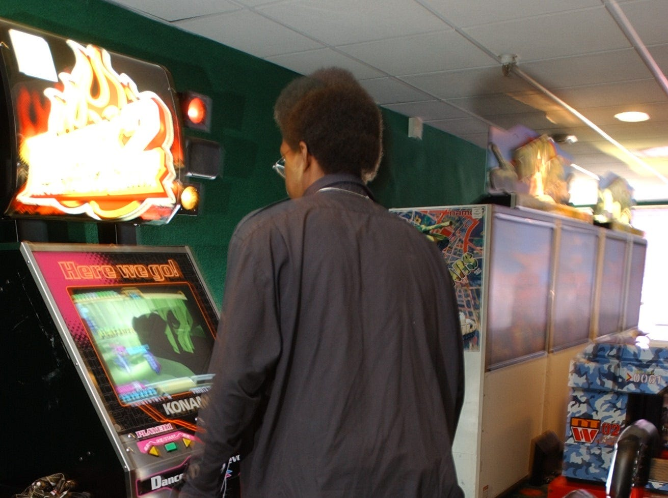 Dance, Dance Revolution video game at Fun N Games arcade at Willowbrook Mall. Johnathan Wright of Passaic takes a turn on the dance machine on July 15, 2002.
