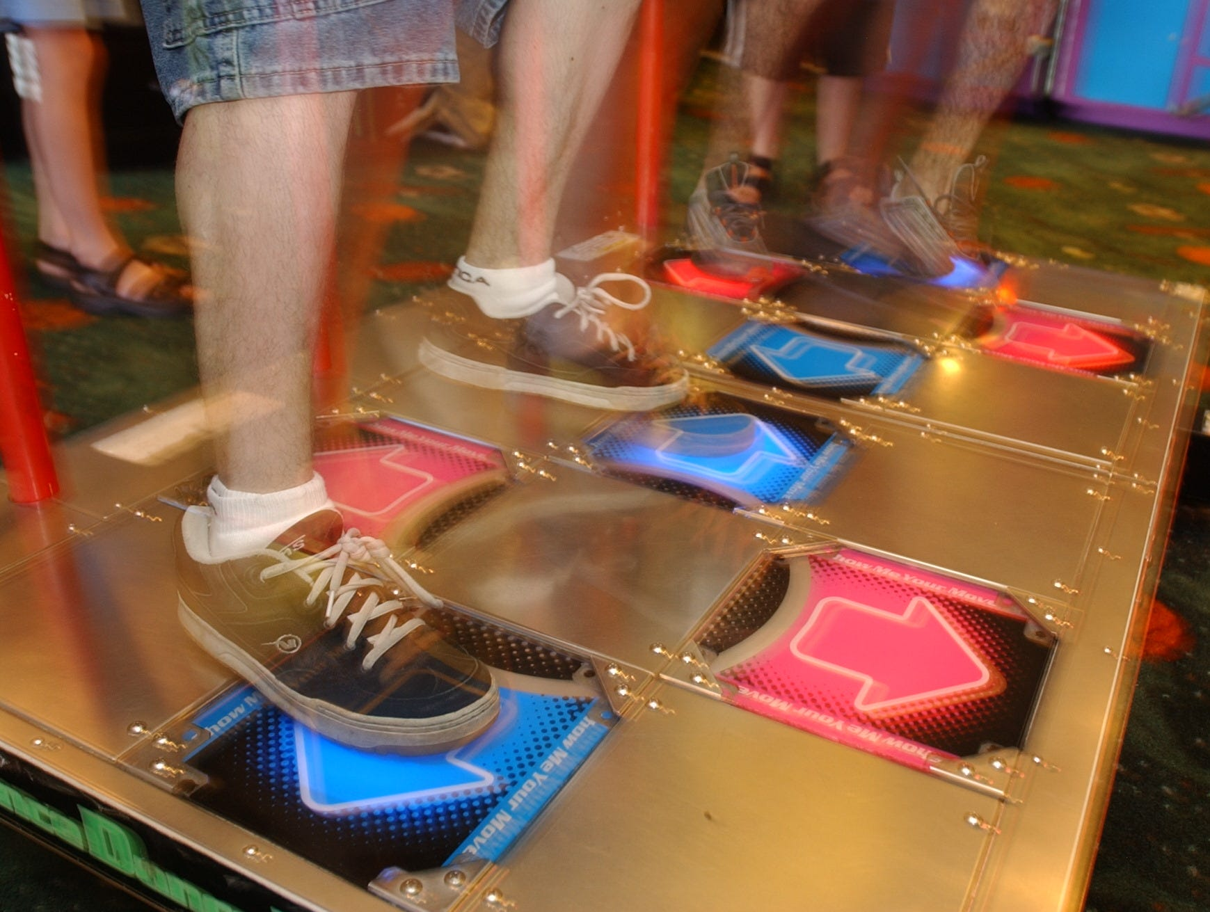 Dance, Dance Revolution video game at Fun N Games arcade at Willowbrook Mall. Lit-up squares on the floor indicate where dancers should step to keep up with the music on July 15, 2002.