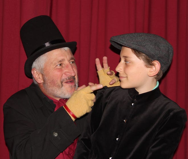 "Oliver Twist (played by Dominick Lusardi, left) learns the tricks of the pickpocket trade from Fagin (Craig Evans) in ""Oliver!""  The musical version of Charles Dickens' tale of an orphan runs at Roy's Hall in Blairstown July 27 through 29."