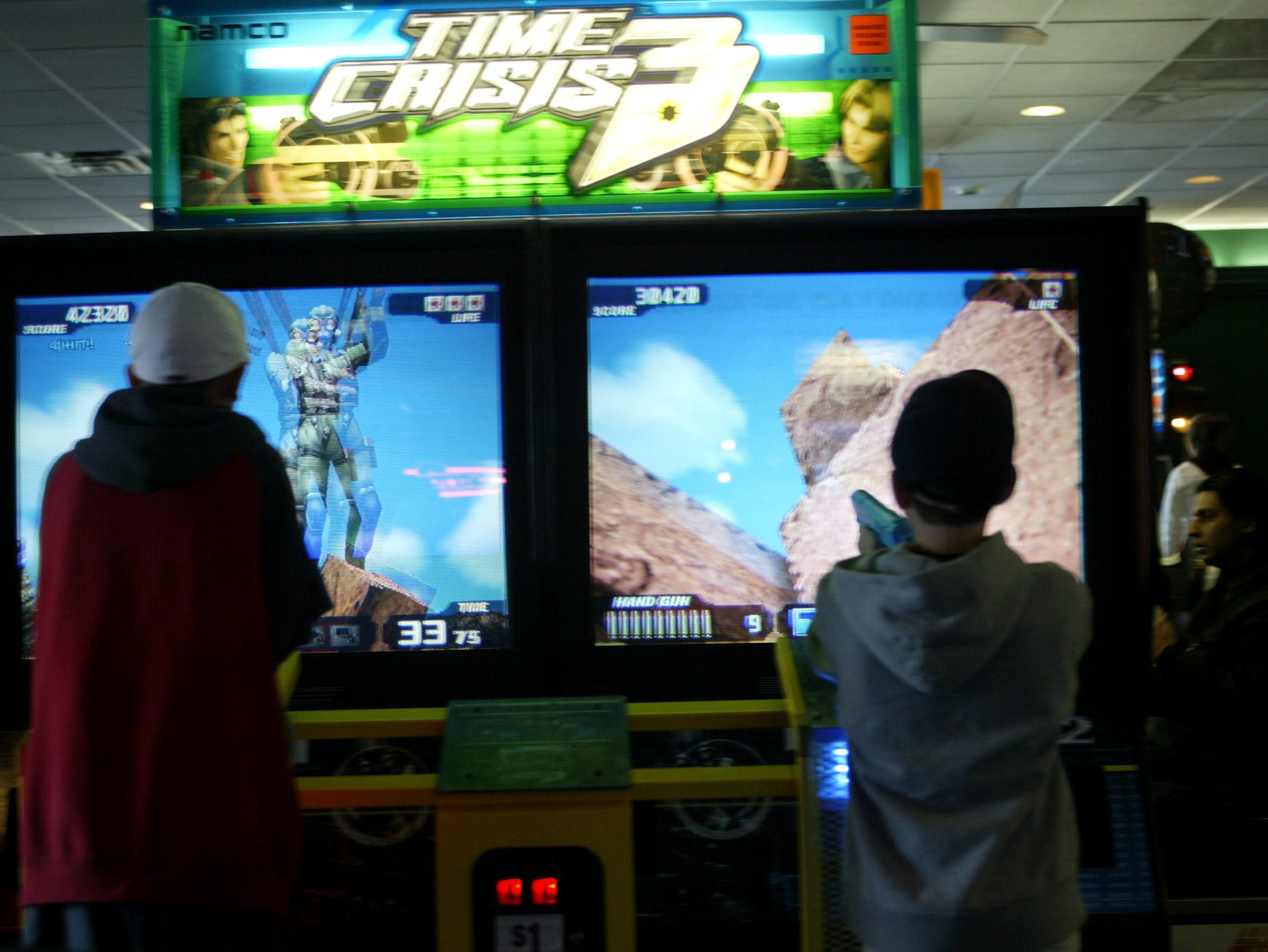 The Fun n' Games Arcade  at the Willowbrook Mall.  Players at Time Crisis 3 on December 20, 2003.