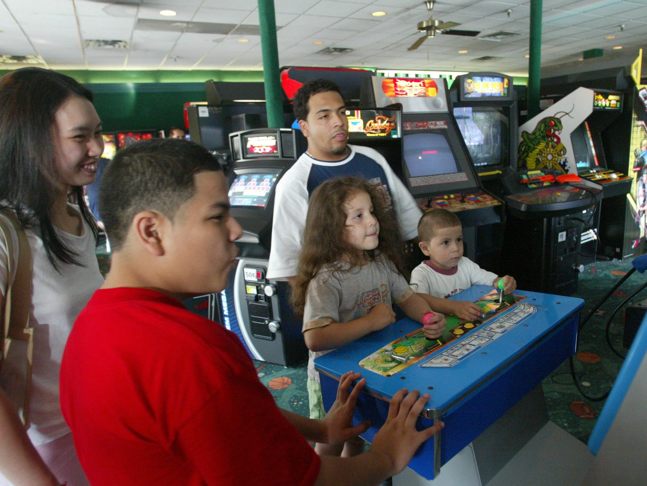 Children play a game at Fun N Games at Willowbrook Mall.