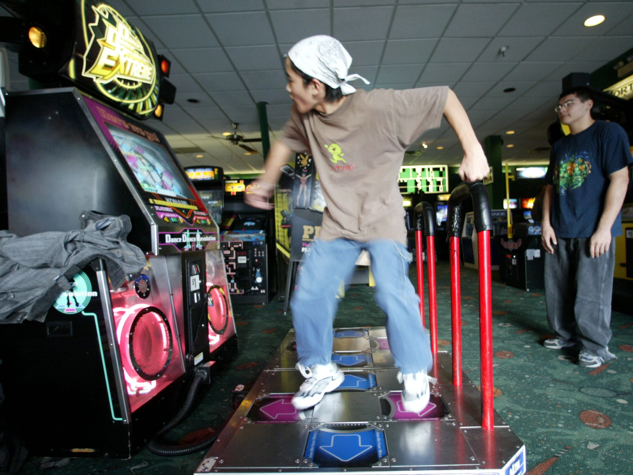 Fun 'N' Games at Willowbrook Mall. Jason Portugal of Bloomfield dances on the platform of the Dance Evolution game on December 18, 2003.