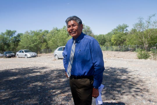 Henry Silentman, an economic development specialist at the Regional Business Development Office in Shiprock, talks about the vehicles stored at the former location of Darrell's Automotive on Tuesday in Shiprock.