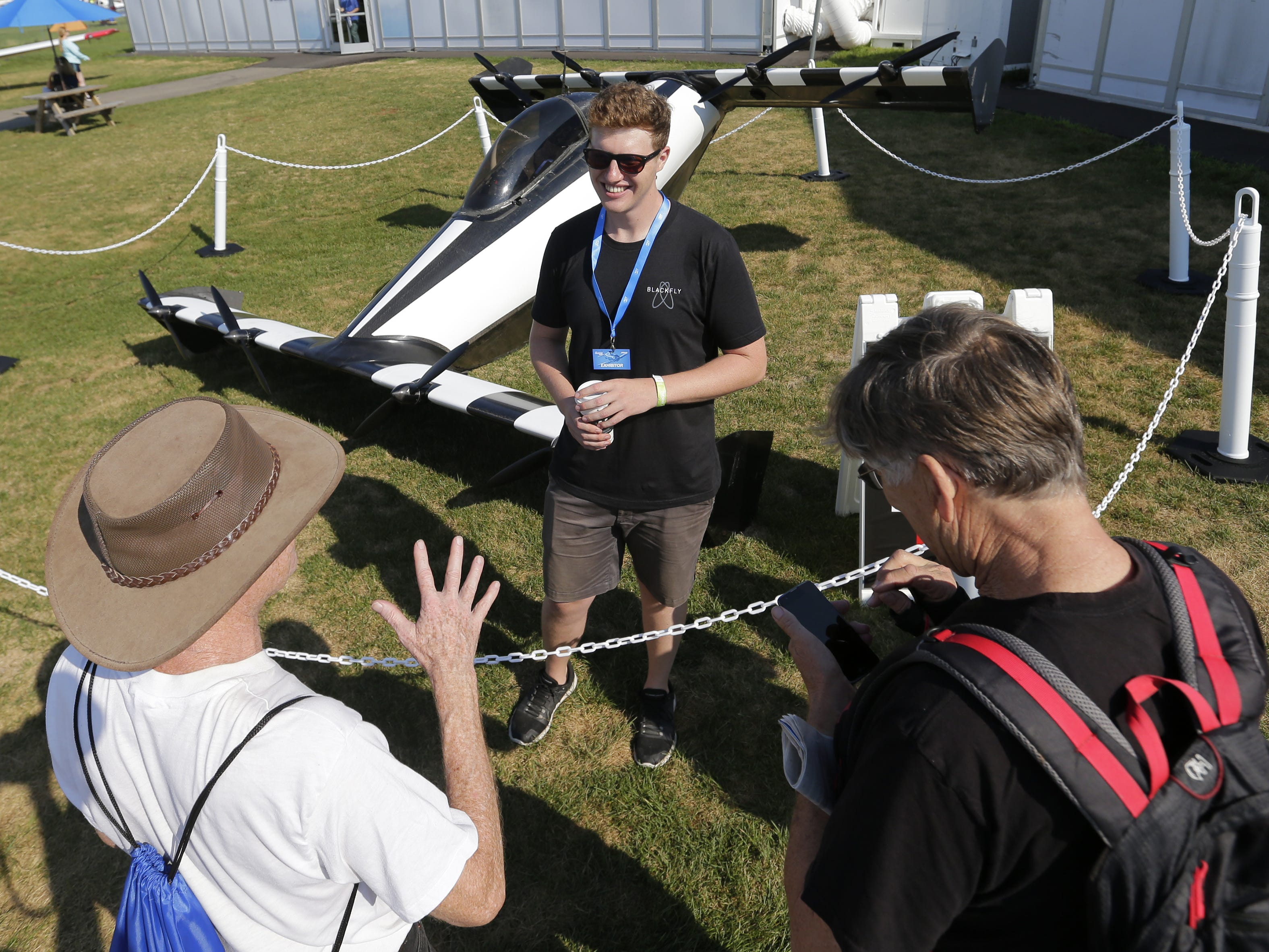 Frank Perkins of Opener based in Palo Alto, talks to spectators about the BlackFly version 2 flying car based in Palo Alto, California Tuesday, July 24, 2018, in Oshkosh, Wis.  The 66th annual Experimental Aircraft Association Fly-In Convention, AirVenture 2018 draws over 500,000 people annually to the area.  The convention runs through July 29. Joe Sienkiewicz/USA Today NETWORK-Wisconsin