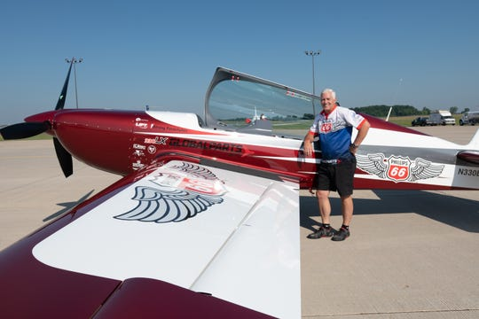 Gerry Molidor of the Aerostars poses before the flight. The Phillips 66 Aerostars practiced aerobatics Tuesday, July 24, 2018, north of Oshkosh. The four-ship team uses Extra aircraft for its performances.