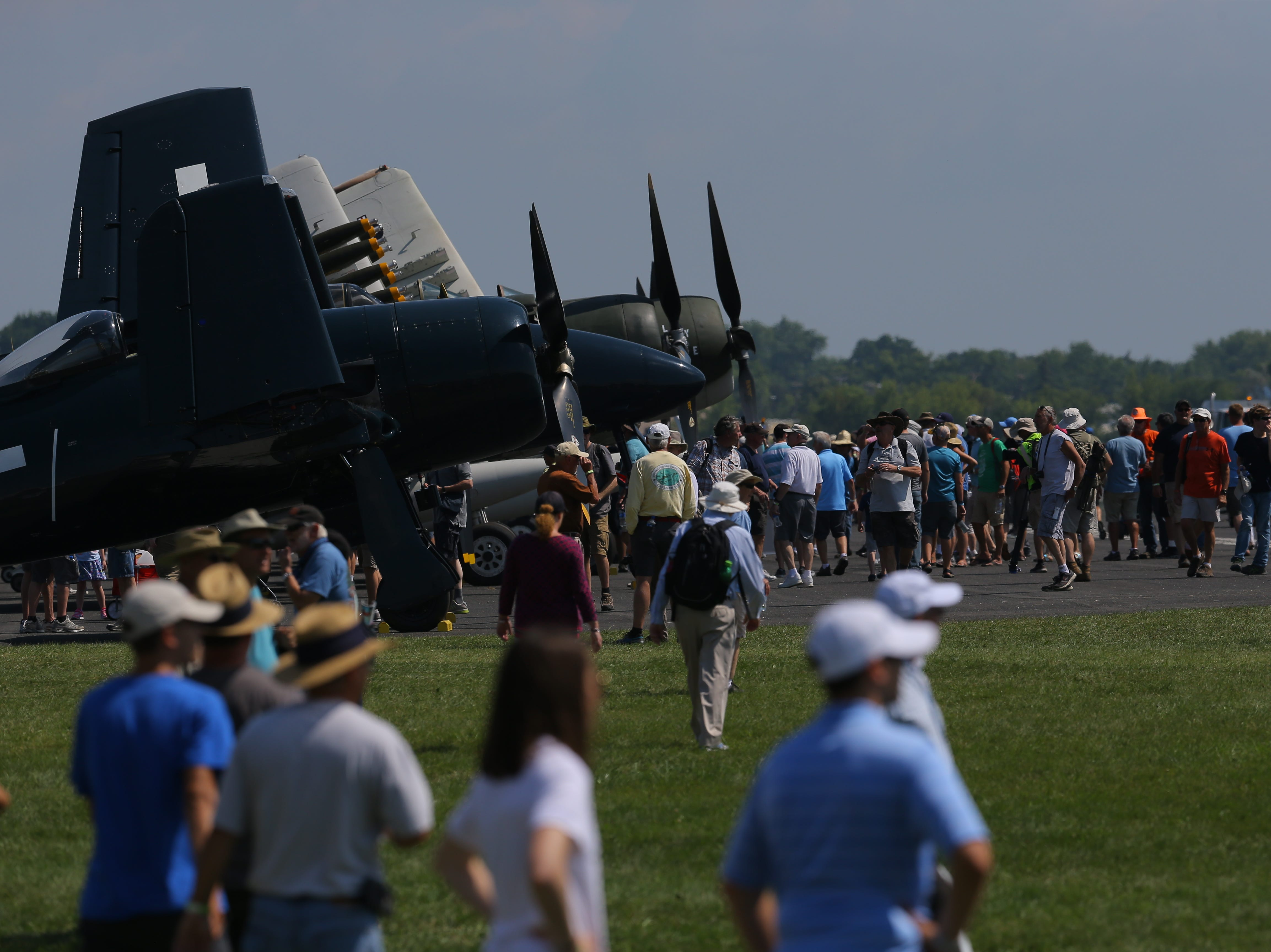 Warbirds were popular for people to look at Tuesday, July 24, 2018, in Oshkosh, Wis.  The 66th annual Experimental Aircraft Association Fly-In Convention, AirVenture 2018 draws over 500,000 people annually to the area.  The convention runs through July 29. Joe Sienkiewicz/USA Today NETWORK-Wisconsin
