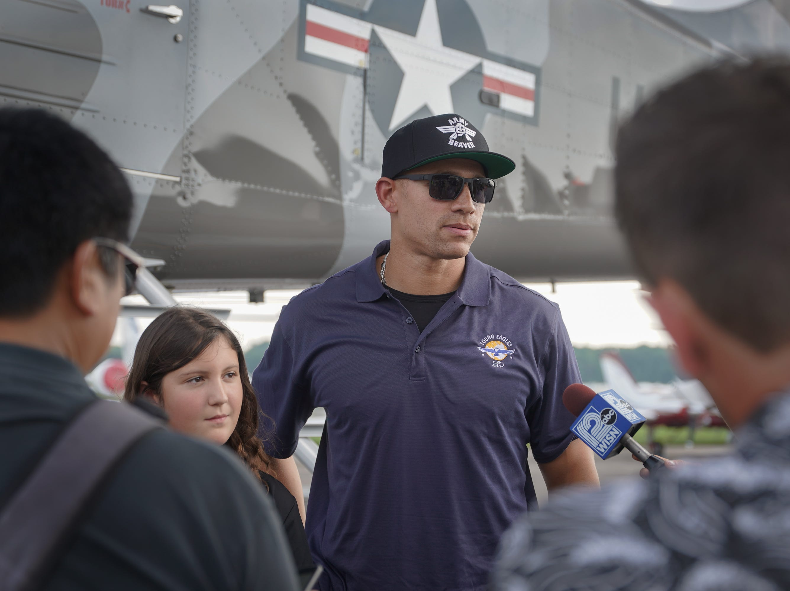 Jimmy Graham talks to the press after his Young Eagles flight. EAA announced  new Young Eagles co-chairman Jimmy Graham with a special flight Monday afternoon. Graham, a Pro Bowl player who is now a tight end with the Green Bay Packers, flew two Young Eagles with Chairman Sean D. Tucker.