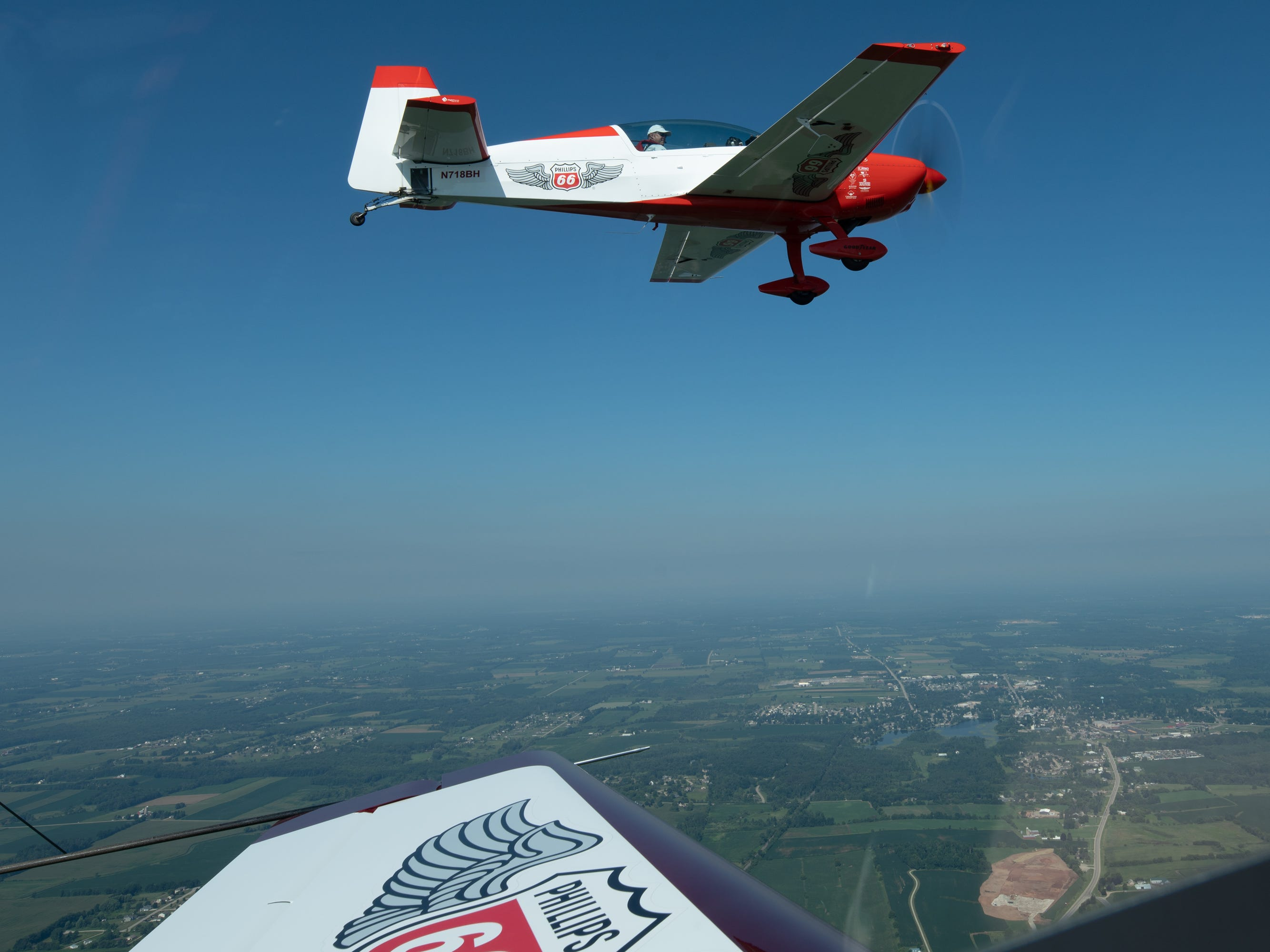 The Phillips 66 Aerostars practice aerobatics Tuesday, July 24, 2018, north of Oshkosh. The four-ship team uses Extra aircraft for its performances.