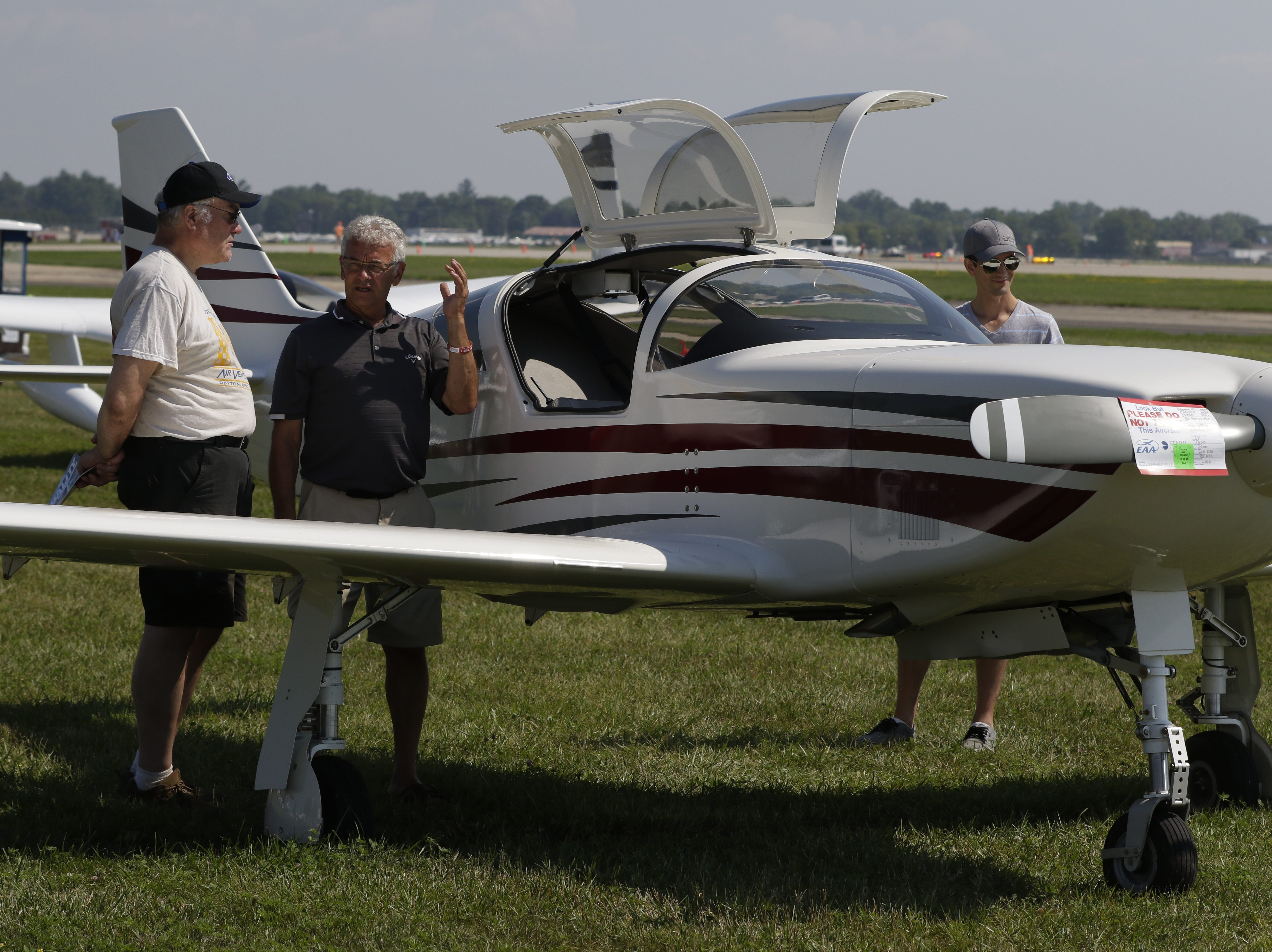 Bob Reilly of Marshfield, Mass., talks with Ed Hoeppner along with Tom Hoeppner of Manitoba, Canada talks about their GlassAir 3, Tuesday, July 24, 2018, in Oshkosh, Wis.  The 66th annual Experimental Aircraft Association Fly-In Convention, AirVenture 2018 draws over 500,000 people annually to the area.  The convention runs through July 29. Joe Sienkiewicz/USA Today NETWORK-Wisconsin