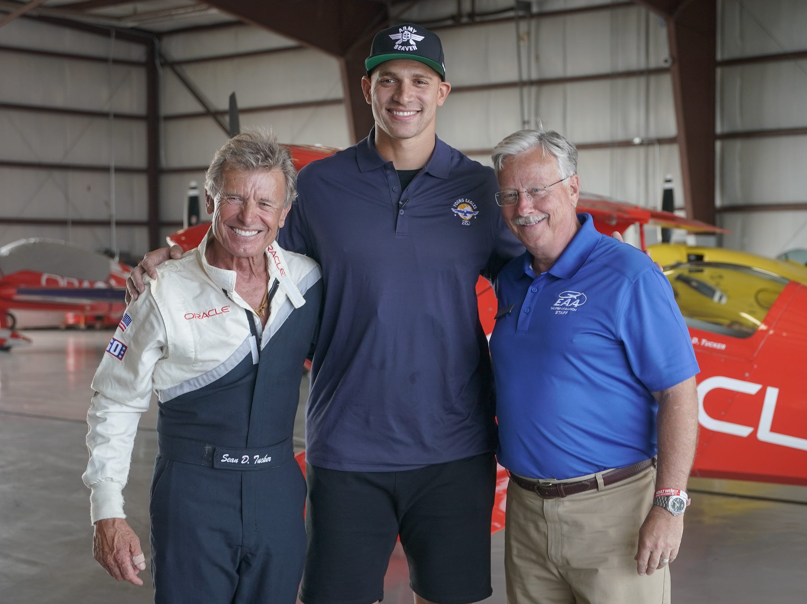 Jimmy Graham poses before the flight with Young Eagles chairman Sean D. Tucker and EAA CEO Jack Pelton. EAA announced  new Young Eagles co-chairman Jimmy Graham with a special flight Monday afternoon. Graham, a Pro Bowl player who is now a tight end with the Green Bay Packers, flew two Young Eagles with Chairman Sean D. Tucker.