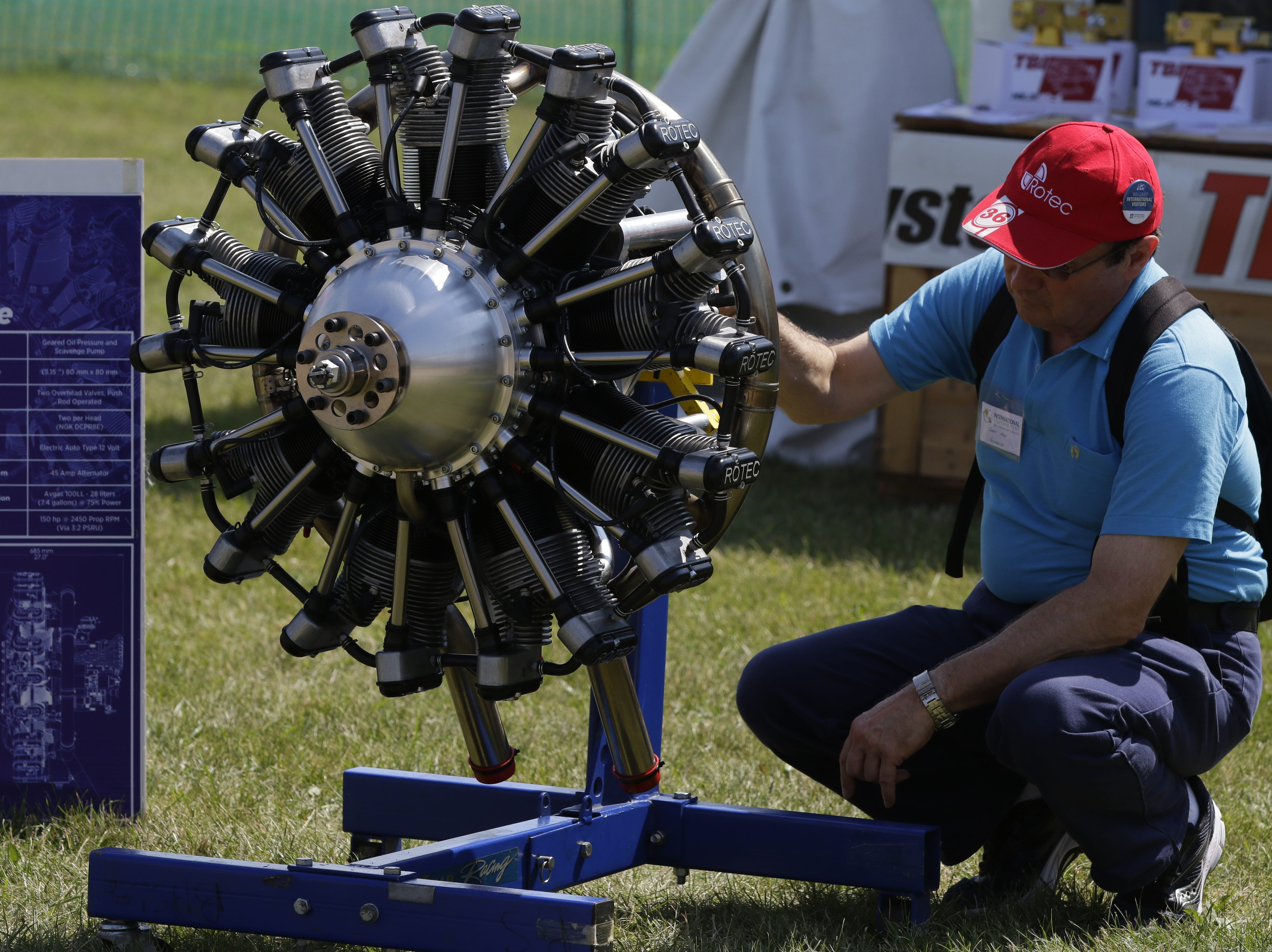 Geoff May of Sydney, Austraila looks over the Rotec R3600 radial engine, Tuesday, July 24, 2018, in Oshkosh, Wis.  The 66th annual Experimental Aircraft Association Fly-In Convention, AirVenture 2018 draws over 500,000 people annually to the area.  The convention runs through July 29. Joe Sienkiewicz/USA Today NETWORK-Wisconsin