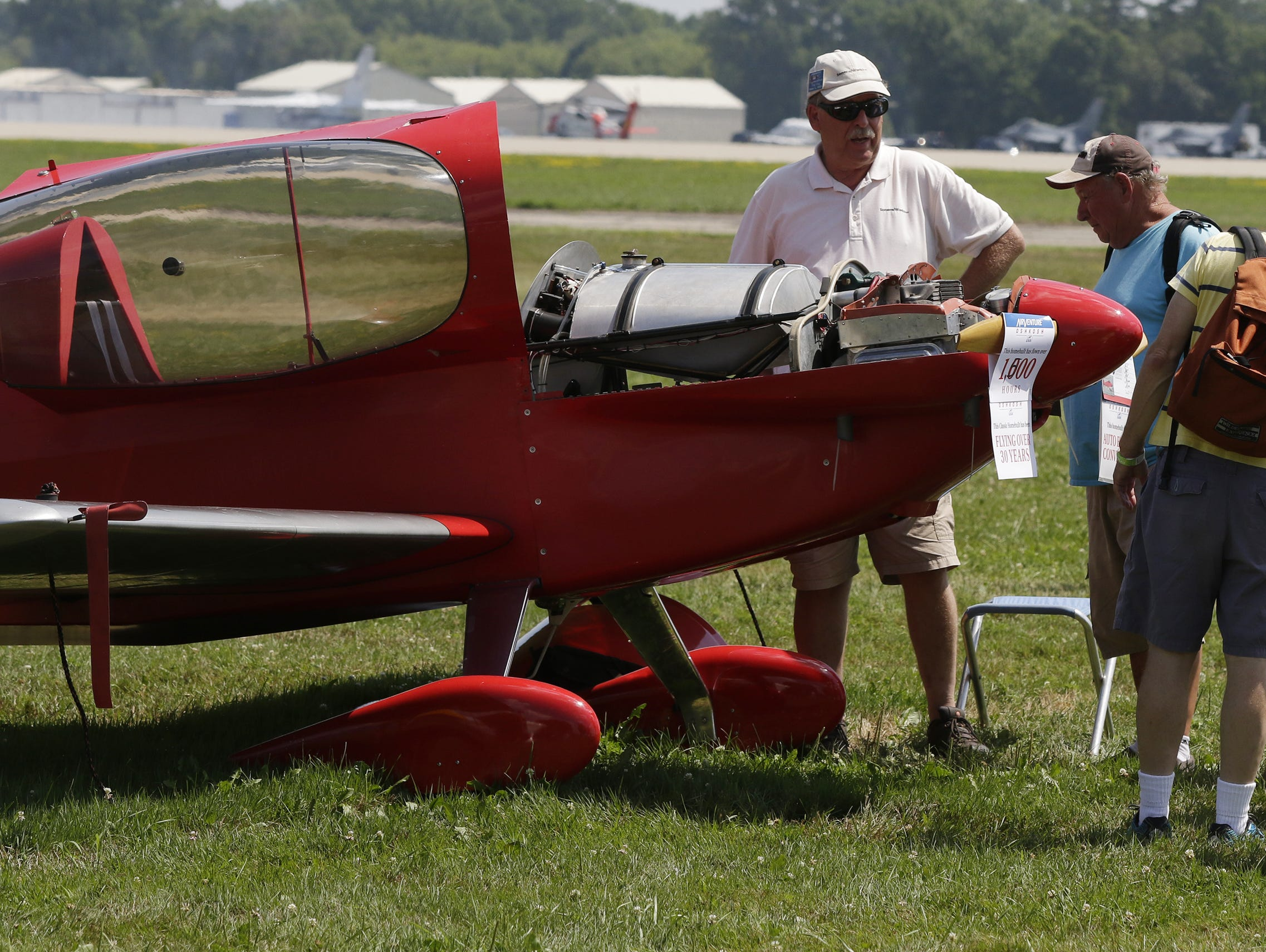 Fred Keip of SoneraiWorks, Franksville, Wis., shows off his car engine powered Sonerai plane that has over 1500 hours on the engine, Tuesday, July 24, 2018, in Oshkosh, Wis.  The 66th annual Experimental Aircraft Association Fly-In Convention, AirVenture 2018 draws over 500,000 people annually to the area.  The convention runs through July 29. Joe Sienkiewicz/USA Today NETWORK-Wisconsin