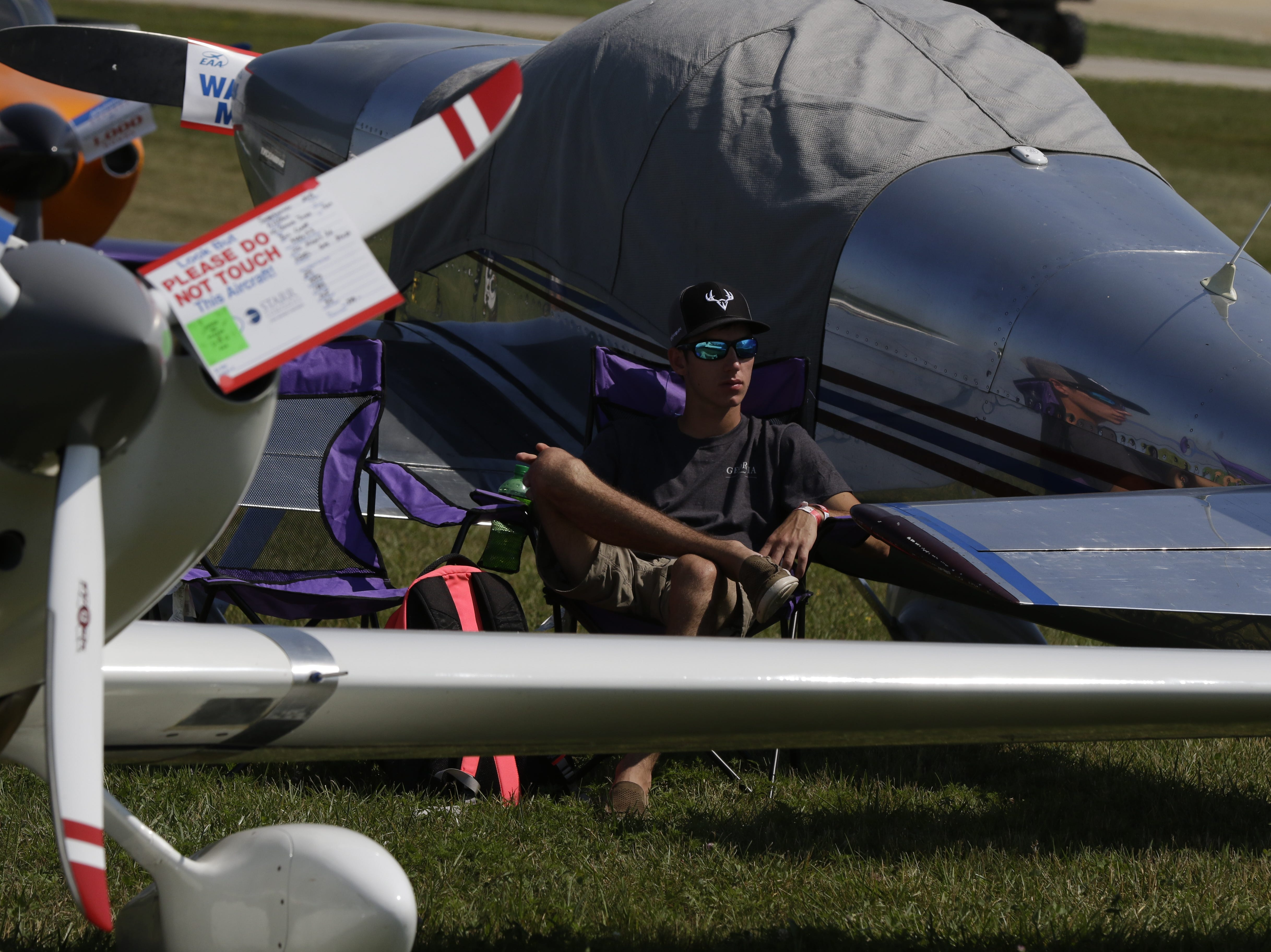 Levi Griffin of Valdosta, Georgia relaxes between plane on the flightline, Tuesday, July 24, 2018, in Oshkosh, Wis.  The 66th annual Experimental Aircraft Association Fly-In Convention, AirVenture 2018 draws over 500,000 people annually to the area.  The convention runs through July 29. Joe Sienkiewicz/USA Today NETWORK-Wisconsin