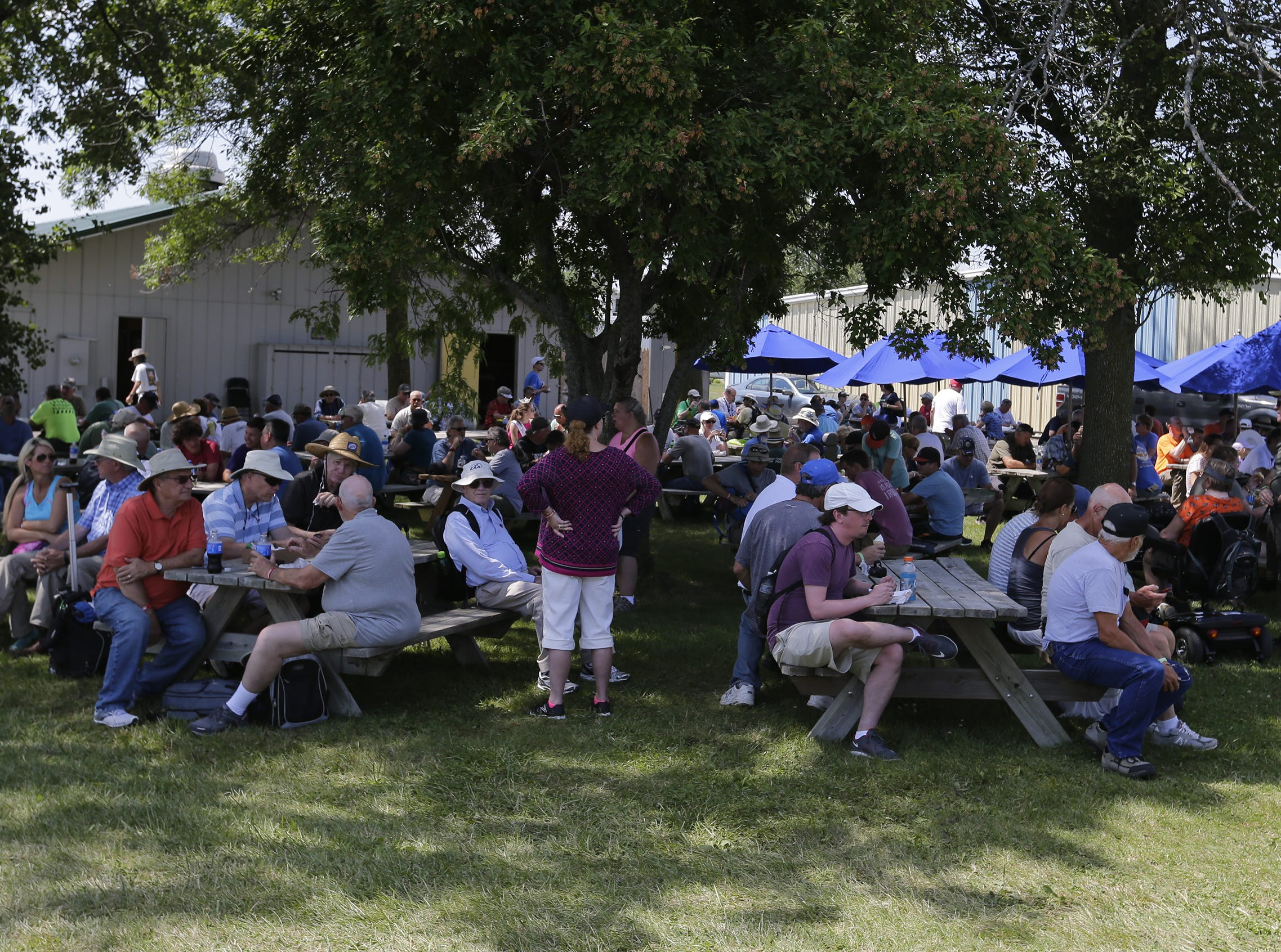 Shade was at a premium during the lunch hour, Tuesday, July 24, 2018, in Oshkosh, Wis.  The 66th annual Experimental Aircraft Association Fly-In Convention, AirVenture 2018 draws over 500,000 people annually to the area.  The convention runs through July 29. Joe Sienkiewicz/USA Today NETWORK-Wisconsin