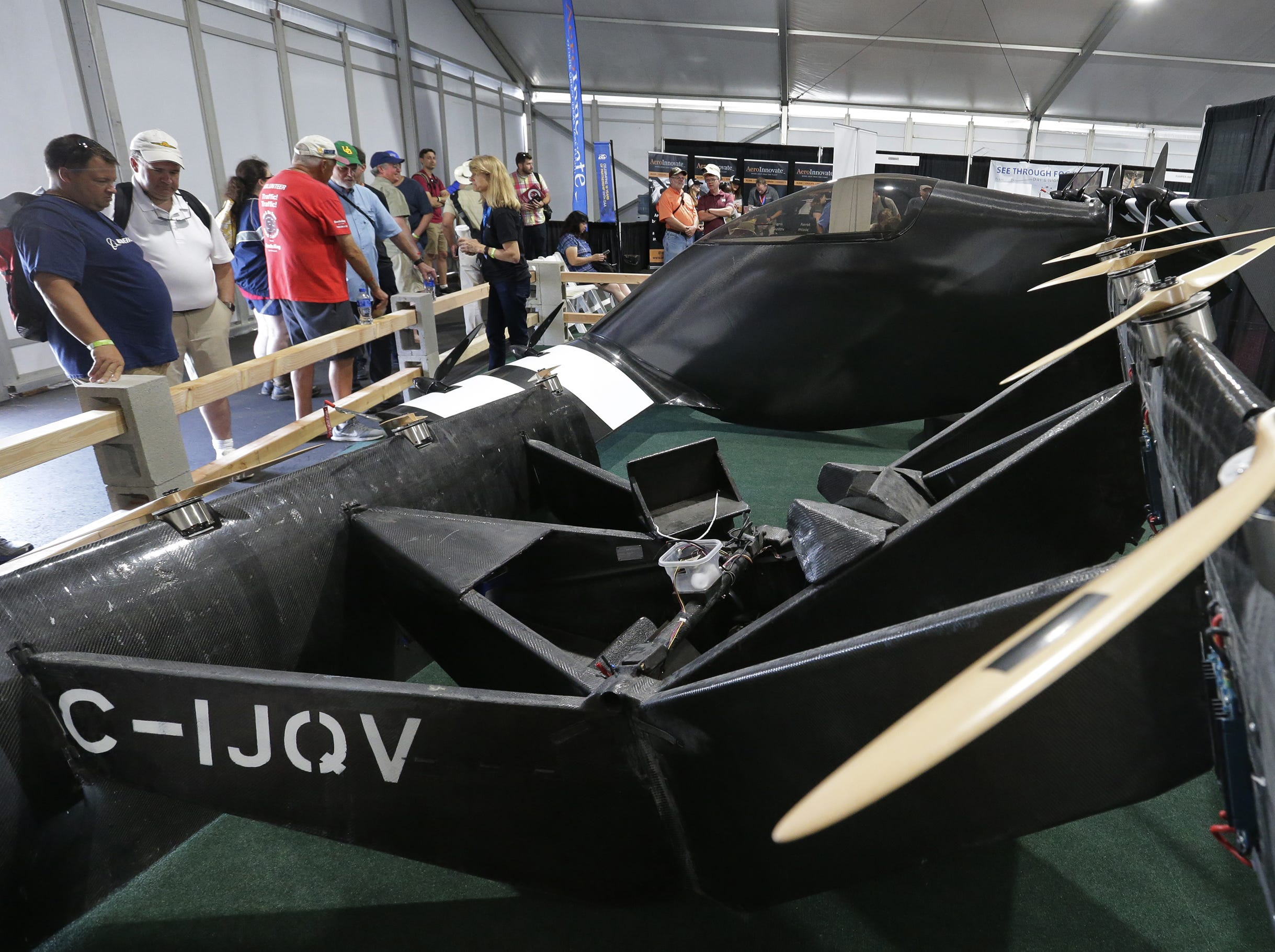 Opener shows off its BlackFly flying car.  Based in Palo Alto, California showcased their flying cars, Tuesday, July 24, 2018, in Oshkosh, Wis.  The 66th annual Experimental Aircraft Association Fly-In Convention, AirVenture 2018 draws over 500,000 people annually to the area.  The convention runs through July 29. Joe Sienkiewicz/USA Today NETWORK-Wisconsin