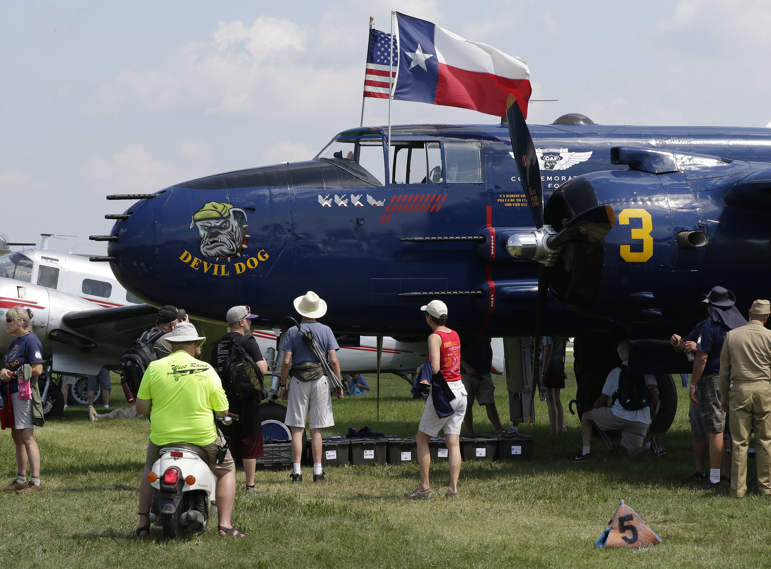 The Devil Dog a PB-1J Doolittle Raider attracted a crowd on the warbird area, Tuesday, July 24, 2018, in Oshkosh, Wis.  The 66th annual Experimental Aircraft Association Fly-In Convention, AirVenture 2018 draws over 500,000 people annually to the area.  The convention runs through July 29. Joe Sienkiewicz/USA Today NETWORK-Wisconsin